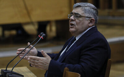 Head of Greece's extreme far-right Golden Dawn party Nikos Michaloliakos testifies, in the Court of Athens as part of a long-running trial over the party's activities in which he and several former party lawmakers are accused of running a criminal organization, in Athens, Wednesday, Nov. 6, 2019. (AP Photo/Petros Giannakouris)