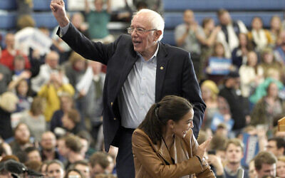Democratic presidential candidate Sen. Bernie Sanders, Independent-Vermont,and Rep. Alexandria Ocasio-Cortez, Democrat-New York, wave to supporters following an election rally on the campus of Iowa Western Community College in Council Bluffs, Iowa, November. 8, 2019. (Nati Harnik/AP)