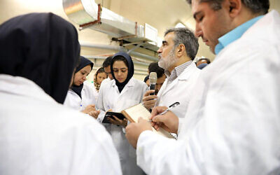 In this photo released by the Atomic Energy Organization of Iran, spokesman of the organization Behrouz Kamalvandi, center, briefs the media while visiting Fordo nuclear site near Qom, south of Tehran, Iran, November 9, 2019 (Atomic Energy Organization of Iran via AP)