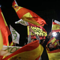 Spain's far-right Vox party supporters cheer after the announcement of the general election first results, in Madrid, Spain,  Nov. 10, 2019  (AP Photo/Andrea Comas)