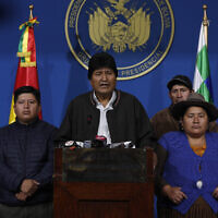 Bolivia's President Evo Morales, center, speaks during a press conference at the military base in El Alto, Bolivia, Nov. 10, 2019  (AP Photo/Juan Karita)