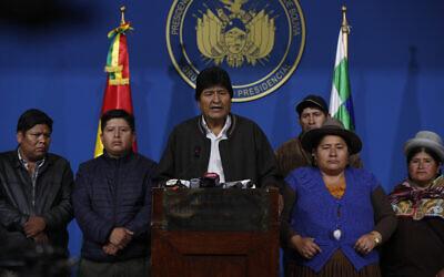 Bolivia's President Evo Morales, center, speaks during a press conference at the military base in El Alto, Bolivia, Nov. 10, 2019  (AP Photo/Juan Karita)