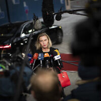 European Union Foreign Policy chief Federica Mogherini talks to journalists as she arrives to an European Foreign Affairs Ministers meeting at the Europa building in Brussels, November 11, 2019. (Francisco Seco/AP)
