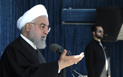 In this photo released by the official website of the office of the Iranian Presidency, President Hassan Rouhani speaks at a public gathering in the city of Rafsanjan in Iran's southwest Kerman province, Monday, November 11, 2019. (Office of the Iranian Presidency via AP)