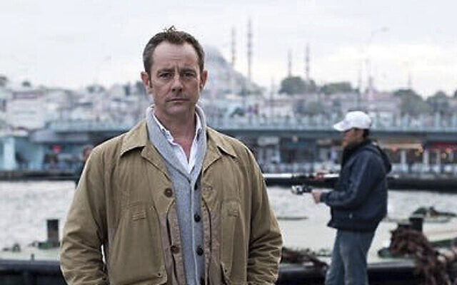 File: Former British army officer James Le Mesurier stands near the Golden Horn in this undated file photo, in Istanbul.  The lifeless body of James Le Mesurier was found early Monday Nov. 11, 2019, in Istanbul, Turkey (AP Photo/File)