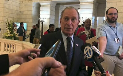 Former New York City mayor Michael Bloomberg talks to the media after filing paperwork to appear on the ballot in Arkansas' March 3 presidential primary, November 12, 2019 in Little Rock, Arkansas. (AP Photo/APTN)