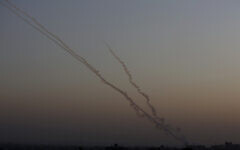 Illustrative: Rockets are launched from the Gaza Strip towards Israel, November 13, 2019. (AP/ Hatem Moussa)