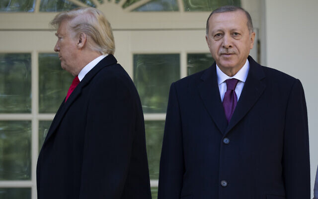 US President Donald Trump, left, walks off toward the Oval Office after posing for photographers with Turkish President Recep Tayyip Erdogan before a meeting in the White House, November 13, 2019, in Washington. (Evan Vucci/AP)