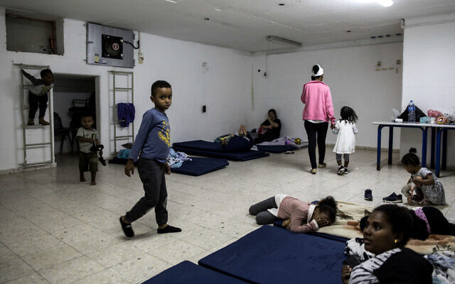 Israeli families in a bomb shelter in the coastal city of Ashkelon, Israel,  November 13, 2019. (Tsafrir Abayov/AP)