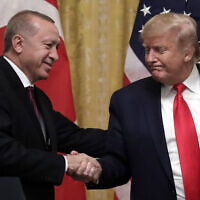 US President Donald Trump shakes hands with Turkish President Recep Tayyip Erdogan after a news conference in the East Room of the White House, Wednesday, Nov. 13, 2019, in Washington. (AP Photo/ Evan Vucci)
