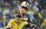 Argentina's Lionel Messi, right, heads the ball past Brazil's Thiago Silva during a friendly soccer match between Brazil and Argentina at King Fahd stadium in Riyadh, Saudi Arabia, on November 15, 2019. (AP Photo)