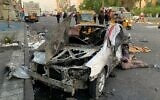 A damaged vehicle sits at the site of a bomb attack near Tahrir square in Baghdad, Iraq, Nov. 16, 2019 (AP Photo/Ali Abdul Hassan)