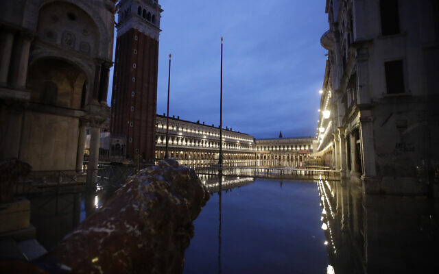 St. Mark's Square is reflected in flood water at dawn in Venice, Italy, November 17, 2019. (AP Photo/Luca Bruno)