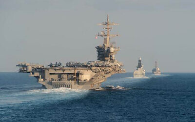 In this photo from the US Navy provided on November 19, 2019, the aircraft carrier USS Abraham Lincoln, left, the air-defense destroyer HMS Defender and the guided-missile destroyer USS Farragut transit the Strait of Hormuz with the guided-missile cruiser USS Leyte Gulf. (Mass Communication Specialist 3rd Class Zachary Pearson/U.S. Navy via AP)
