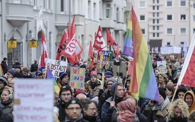 People take part in a protest rally against the German far-right party NPD in Hannover, Germany, Saturday, Nov. 23, 2019. (Ole Spata/dpa via AP)