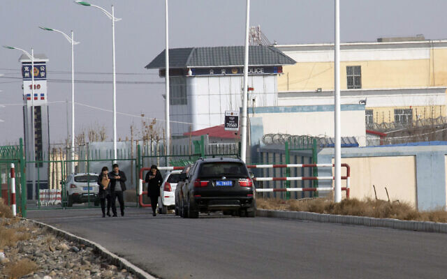 In this Dec. 3, 2018, file photo, a police station is seen by the front gate of the Artux City Vocational Skills Education Training Service Center in Artux in western China's Xinjiang region. Confidential documents, leaked to a consortium of news organizations, lay out the Chinese government's deliberate strategy to lock up ethnic minorities to rewire their thoughts and the language they speak.  (AP Photo/File)