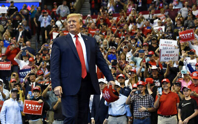 US President Donald Trump arrives to speak at a campaign rally in Sunrise, Florida, Nov. 26, 2019 (AP Photo/Susan Walsh)