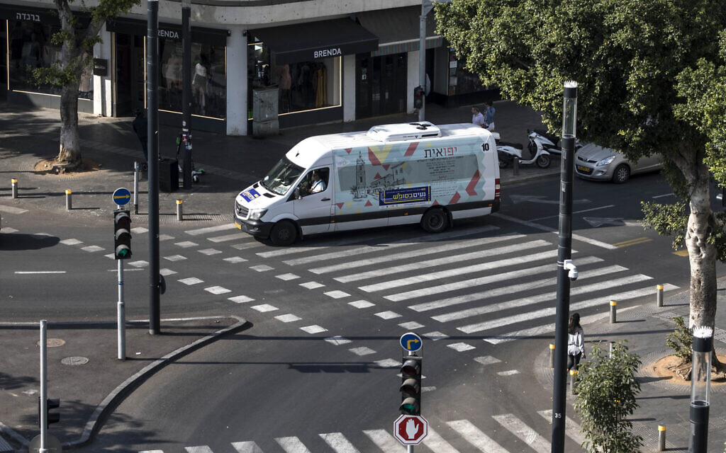 A public transport minibus drives through central Tel Aviv on Saturday, November 23, 2019. (Tsafrir Abayov/AP)