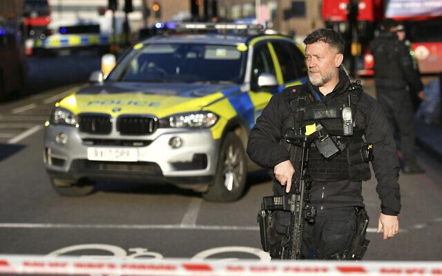 Police at the scene of a stabbing incident on London Bridge in central London, Friday, November 29, 2019 (Dominic Lipinski/PA via AP)