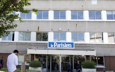 A man enters the headquarters of French newspaper Le Parisien in Saint-Ouen, outside Paris, France, June 4, 2015. (Jacques Brinon/AP)