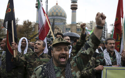 File: Iranian Basij paramilitary forces chant slogans during a rally marking the 35th anniversary of establishment of the force, at  Felestin (Palestine) square in Tehran, Iran, in 2014 (AP Photo/Vahid Salemi)