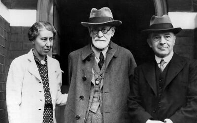 Psychoanalyst Sigmund Freud, center, poses with his daughter Mathilde, left, and Dr. Ernest Jones on his arrival at his Hampstead home in London, England, on June 6, 1938 (AP Photo)