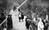 German refugee passing the Russian barrier to move east from the American zone at Gros Topfer, the exchange point, on November 6, 1945. (AP Photo)