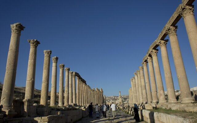 Illustrative: Tourists walk through the main street, the South Cardo, in the well preserved Ancient Roman city of Gerasa, in the city of Jerash, Jordan, November 13, 2015. (AP Photo/Nasser Nasser)