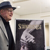 Croatian Auschwitz survivor Branko Lustig stands next to a poster of the film Schindler's List at Yad Vashem Holocaust memorial in Jerusalem, July 22, 2015. (Nir Elias/Pool Photo via AP)