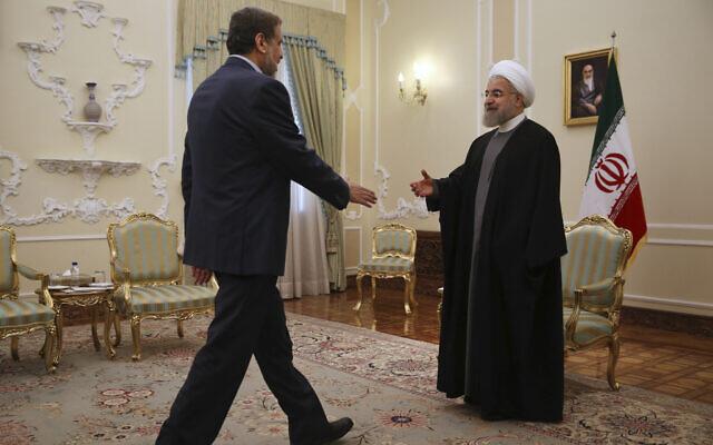 Iranian President Hassan Rouhani, right, welcomes head of the Palestinian Islamic Jihad Ramadan Abdullah Shallah for their meeting at the presidency office in Tehran, Iran, Thursday, May 5, 2016. (AP Photo/Vahid Salemi)