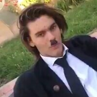 A student from Argentina dressed as Adolf Hitler in a parody music video (Screencapture/Twitter)