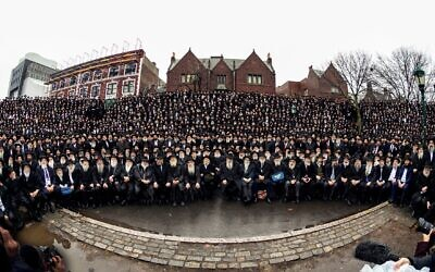 """Thousands of rabbis who serve as emissaries for the Chabad-Lubavitch movement pose for their annual """"class picture"""" in front of Chabad headquarters in Crown Heights, Brooklyn, November 24, 2019. (Mendel Grossbaum / Chabad.org via JTA)"""