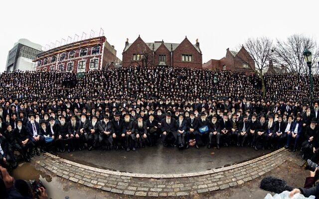 "Thousands of rabbis who serve as emissaries for the Chabad-Lubavitch movement pose for their annual ""class picture"" in front of Chabad headquarters in Crown Heights, Brooklyn, November 24, 2019. (Mendel Grossbaum / Chabad.org via JTA)"