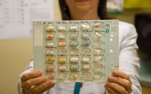 Dr. Neora Pick holds a selection of antiretroviral medications for HIV positive patients at the Oak Tree Clinic. (Etye Sarner)