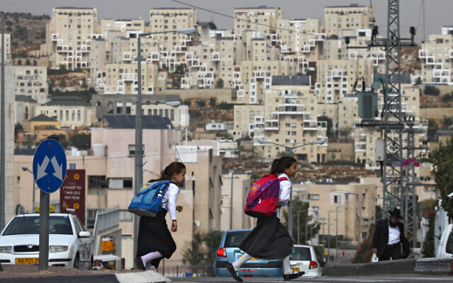 Illustrative: Ultra-Orthodox girls on their way to school in a West Bank settlement, October 2009. (Nati Shohat/Flash90)