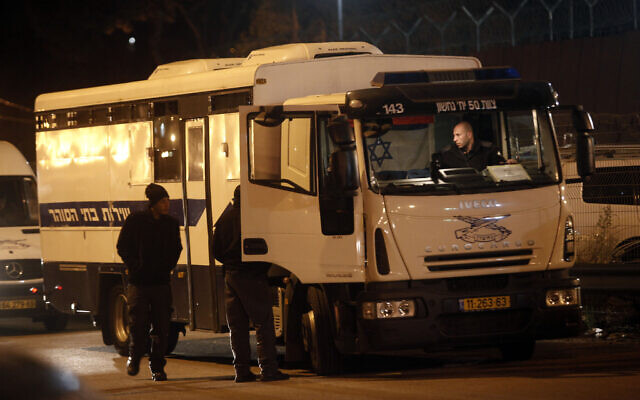Illustrative: A bus of the Israeli Prison Service transporting prisoners, December 18, 2011. (Uri Lenz/FLASH90)