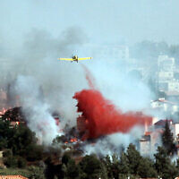 Illustrative: Airplanes and  firefighters try to extinguish a forest fire which raged in Mevaseret Zion, just outside of Jerusalem. July 15, 2012. (Yossi Zamir/Flash 90)