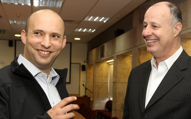 Naftali Bennett (L) and Tzachi Hanegbi before a political debate at the Hebrew University in Jerusalem, January 8, 2013. (Miriam Alster/Flash90)