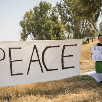 A 'Peace' sign hangs in a field near the border with Gaza, as thousands of Palestinians demonstrate near the border with Israel in the Gaza Strip, on April 6, 2018. (Hadas Parush/Flash90)