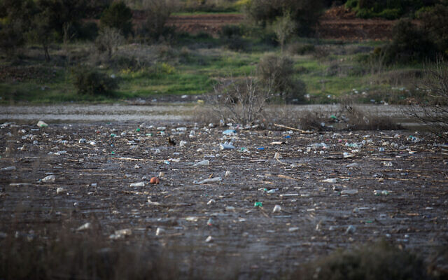 View of plastic bottles and other trash in the Beit Zait water reservoir near Jerusalem on March 1, 2019. (Hadas Parush/Flash90)