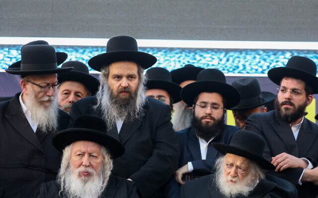 Yaakov Litzman, left, and Rabbi Yaakov Aryeh Alter of the Gur Hassidic Dynasty, second left, attend a rally of United Torah Judaism party in Jerusalem, April 8, 2019.  Noam Revkin Fenton/Flash90)