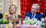 Sara Netanyahu, left, and her husband Prime Minister Benjamin Netanyau, right, attend the Jewish Moroccan celebration of Mimuna, in Or Akiva on April 27, 2019.( Flash90)