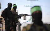 Palestinian fighters from the military wings of the Hamas and Islamic Jihad terror groups are seen in Gaza City during the holy month of Ramadan. (Hassan Jedi/Flash90)  *** Local Caption *** øîàãï øîãï ôìñèéðéí ìåçîéí çîàñ òæä øöåòú òæä â'éäàã àéñìîé àì ÷åãñ