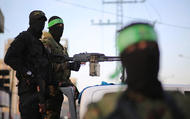 Palestinian fighters from the military wings of the Hamas and Islamic Jihad terror groups are seen in Gaza City during the holy month of Ramadan, November 2, 2019. (Hassan Jedi/Flash90)