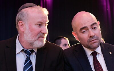 Attorney General Avichai Mandelblit (L) and Justice Minister Amir Ohana attend an annual Justice Ministry conference in Airport City outside Tel Aviv on September 3, 2019. (Tomer Neuberg/Flash90)