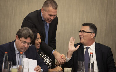 Likud members Gideon Sa'ar (R),  Gilad Erdan (2R), Miri Regev (2L) and Ofir Akunis (L) at a Likud party faction meeting in Jerusalem, following the election results, September 18, 2019 (Hadas Parush/Flash90)