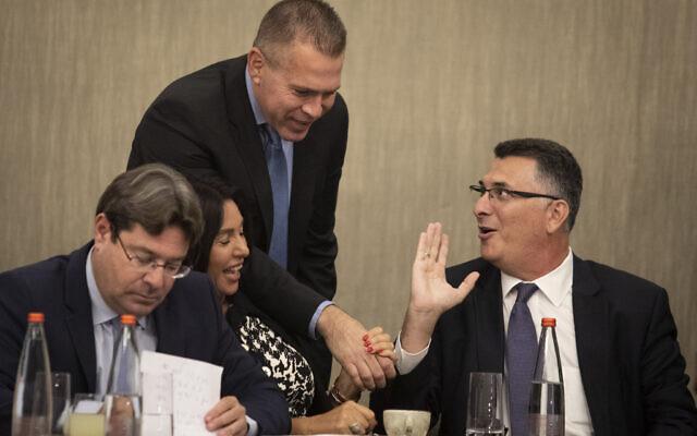 Likud members Gideon Sa'ar (R),  Gilad Erdan (2R), Miri Regev (2L) and Ofir Akunis (L) at a Likud party faction meeting in Jerusalem, following the election results, September 18, 2019 (Hadas Parush/Flash90)