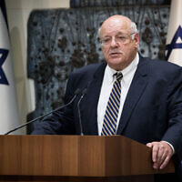 Supreme Court Justice Hanan Melcer, the chairman of the Central Elections Committee, presents the official results of the elections for the 22nd Knesset to President Reuven Rivlin (unseen), at the President's Residence in Jerusalem, September 25, 2019. (Yonatan Sindel/Flash90)