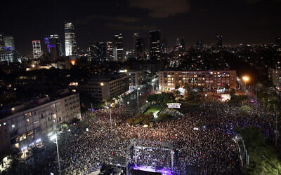 Israelis attend a rally marking 24 years since the assassination of late Israeli Prime Minister Yitzhak Rabin, at Tel Aviv's Rabin Square on November 2, 2019 (Miriam Alster/Flash90)