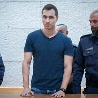 Aleksey Burkov, a Russian hacker slated for extradition to the United States, arrives for a hearing at the High Court of Justice in Jerusalem on November 3, 2019. (Yonatan Sindel/Flash90)